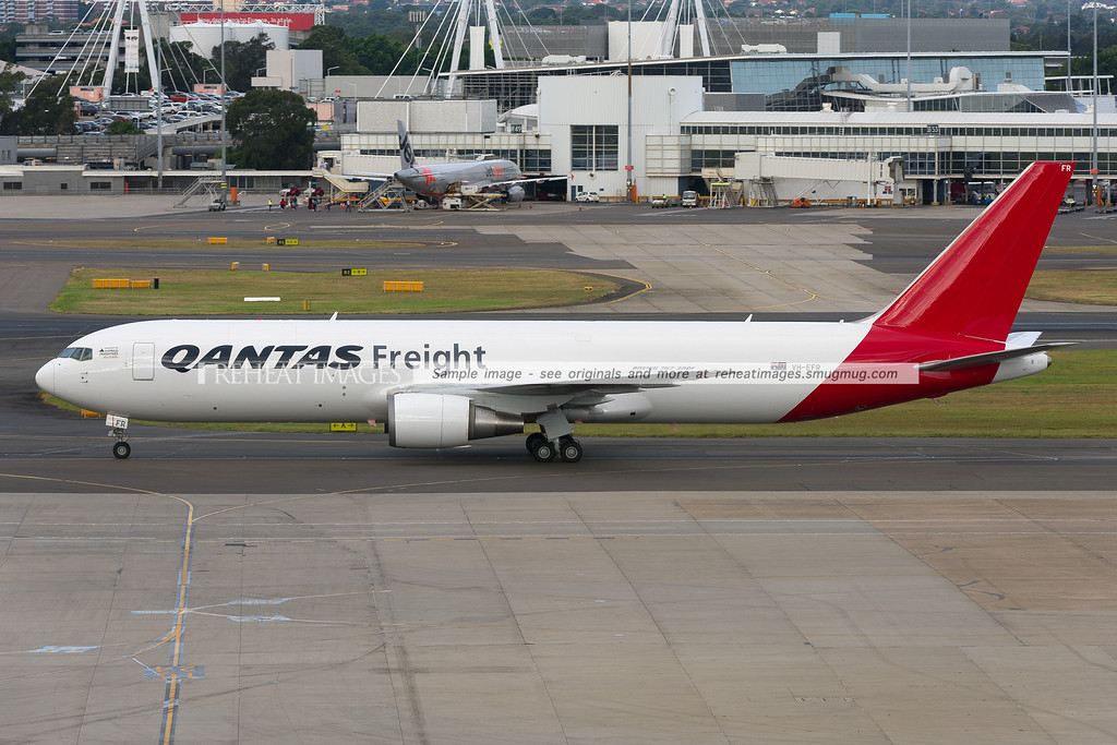 A Qantas Freight (Express Freighters Australia) Boeing 767-381F/ER in Sydney airport. The plane is seen here taxiing to the freight apron at Sydney airport after it returned from the inaugural Qantas Freight service to Auckland.