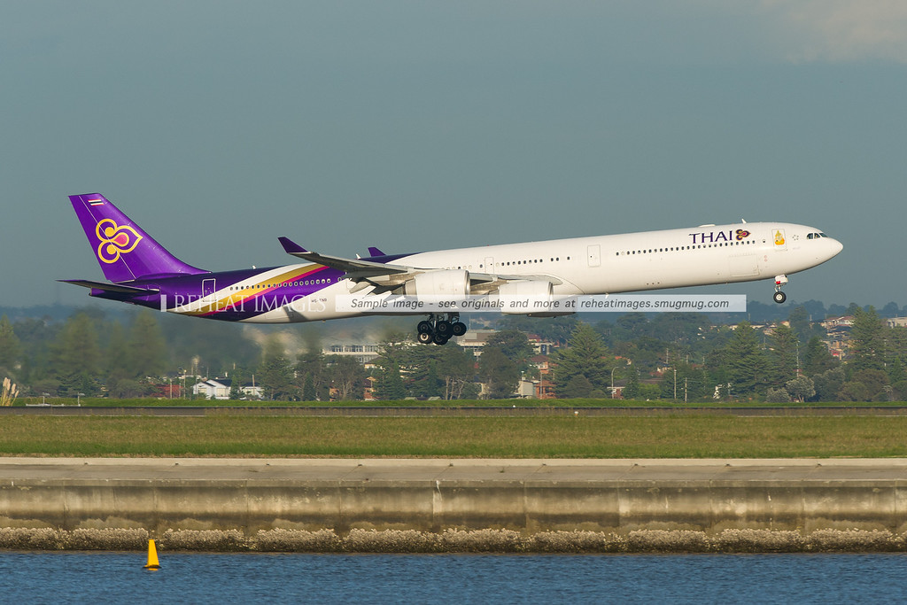 Thai A340-642 is landing at Sydney airport runway 34 left.