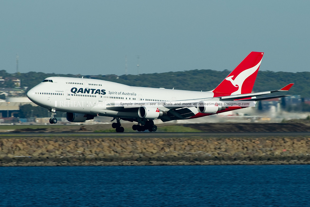 A Qantas Boeing 747-438/ER lands at Sydney airport on runway 34 left.