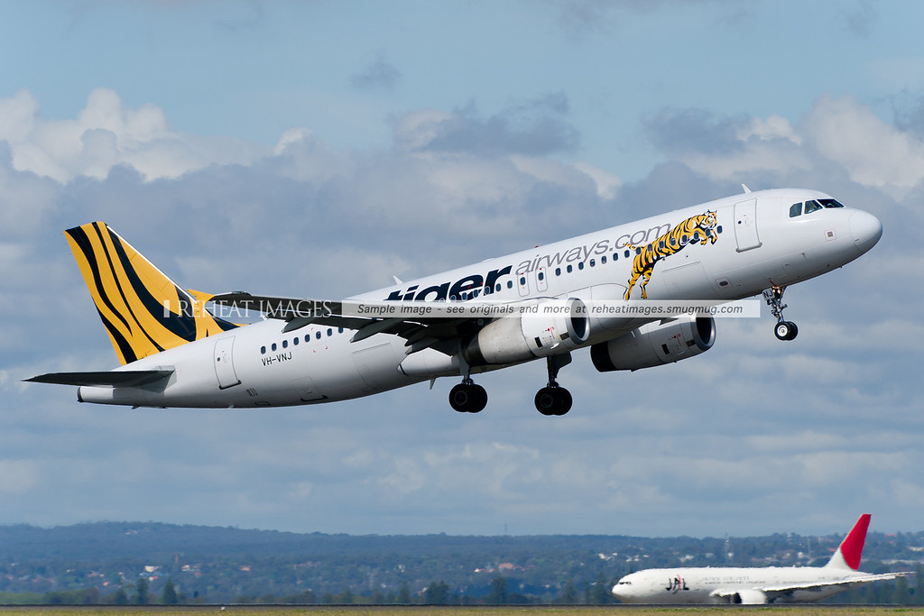 A Tiger Airways Airbus A320 takes off from runway 34 right at Sydney airport.