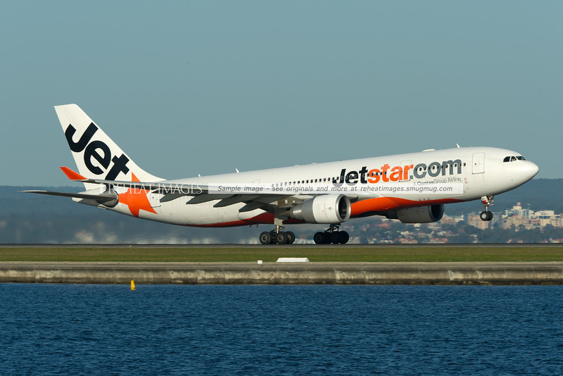 The lone white Jetstar A330 takes off from runway 34 right at Sydney airport.