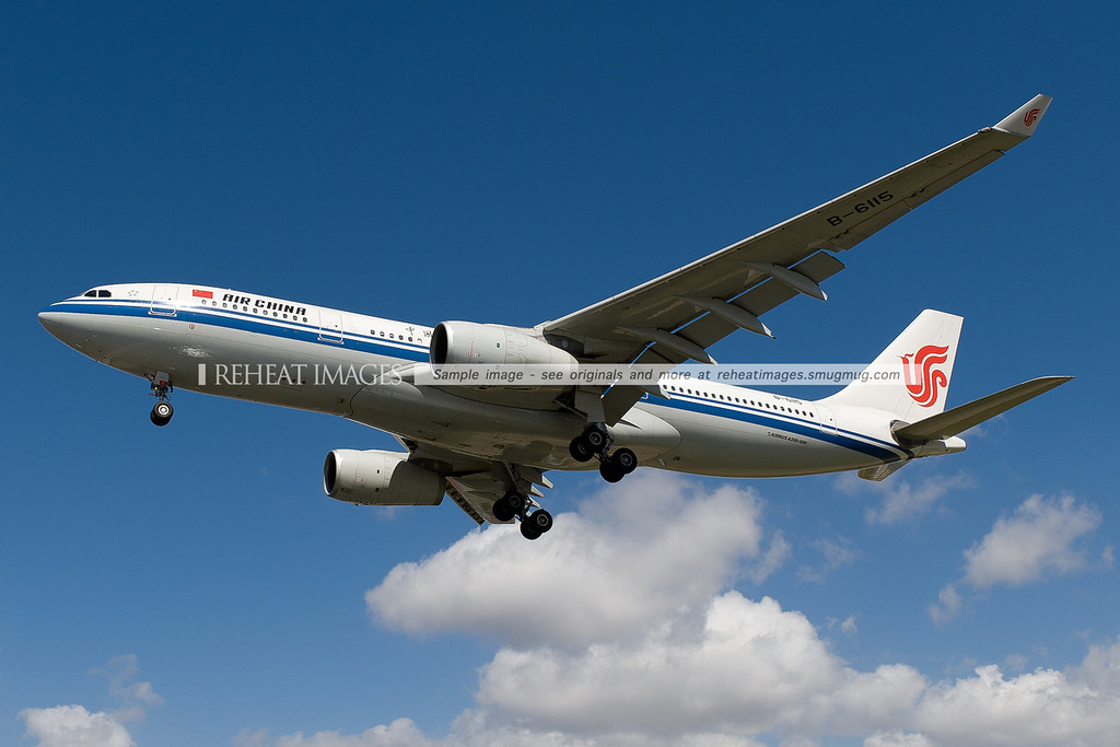 Air China Airbus A330 lands at Sydney airport. It is seen here passing very low over Qantas Drive.