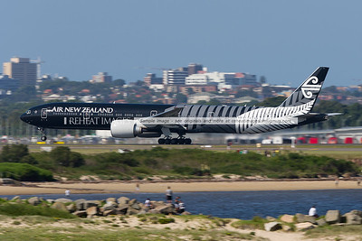 Air New Zealand Boeing B777-319/ER in the 'All Blacks' colour scheme leaves Sydney airport.