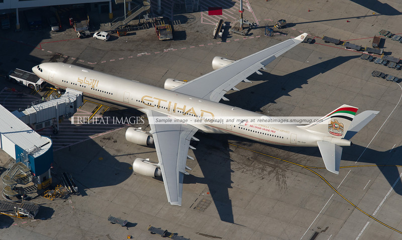 Etihad's Airbus A340-600 A6-EHF is seen here parked at Sydney Airport with the tug connected. It will soon be pushed back.