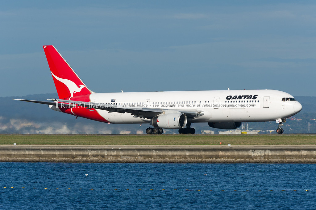 A Qantas Boeing 767-336/ER VH-ZXB departs Sydney airport on runway 34 right.