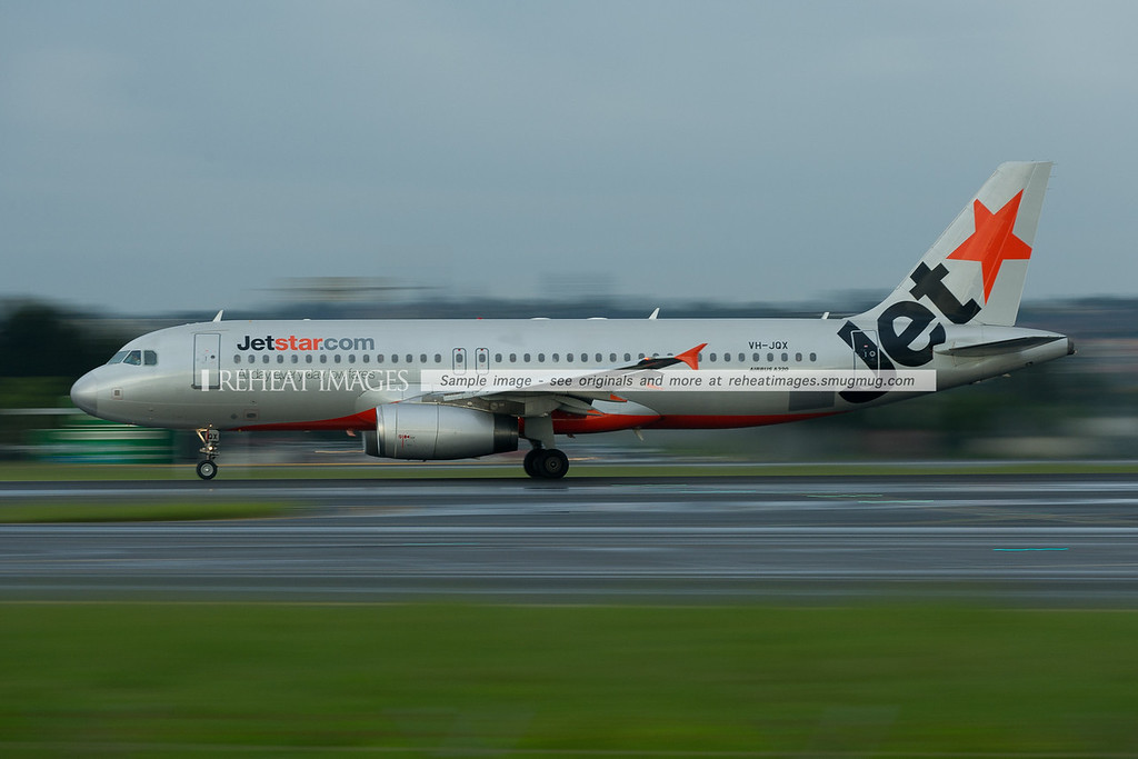 A Jetstar Airbus A320 departs Sydney wearing various shades of silver.