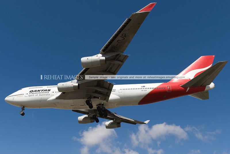 Qantas Boeing 747-438 lands at Sydney airport. It is seen here passing very low over Qantas Drive.