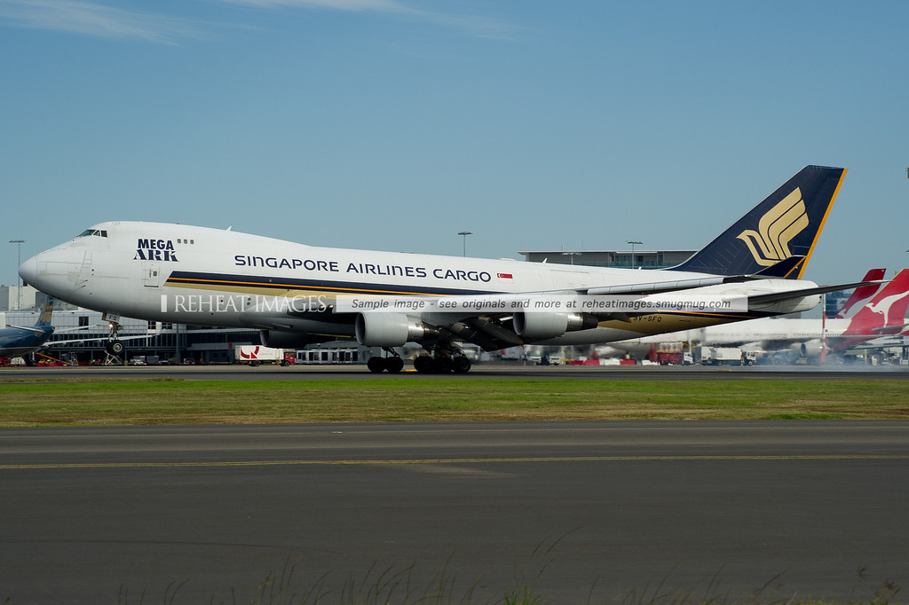 Singapore Airlines Cargo B747-412F lands on runway 16 right at Sydney airport, touching down right in front of me.