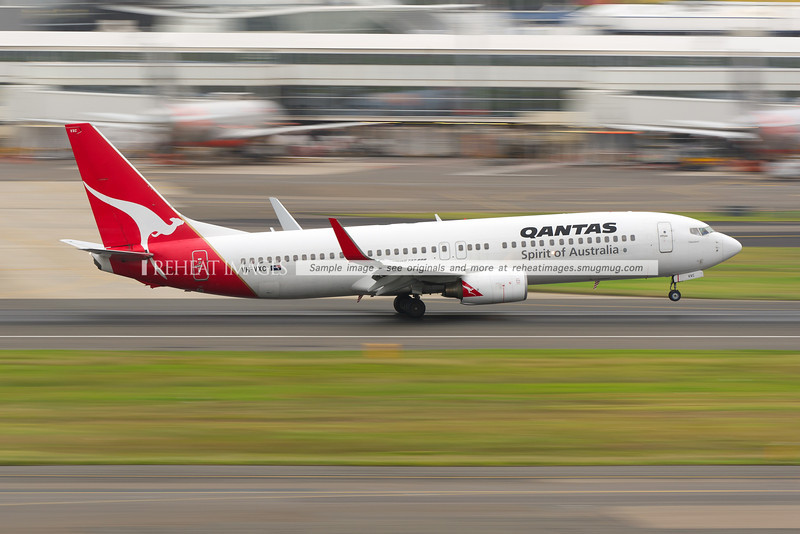 A Qantas Boeing 737-838 VH-VXC arrives at Sydney airport on runway 16 right.