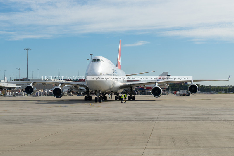 Qantas B747-438 VH-OJQ has pushed back and the engines are about to be started.