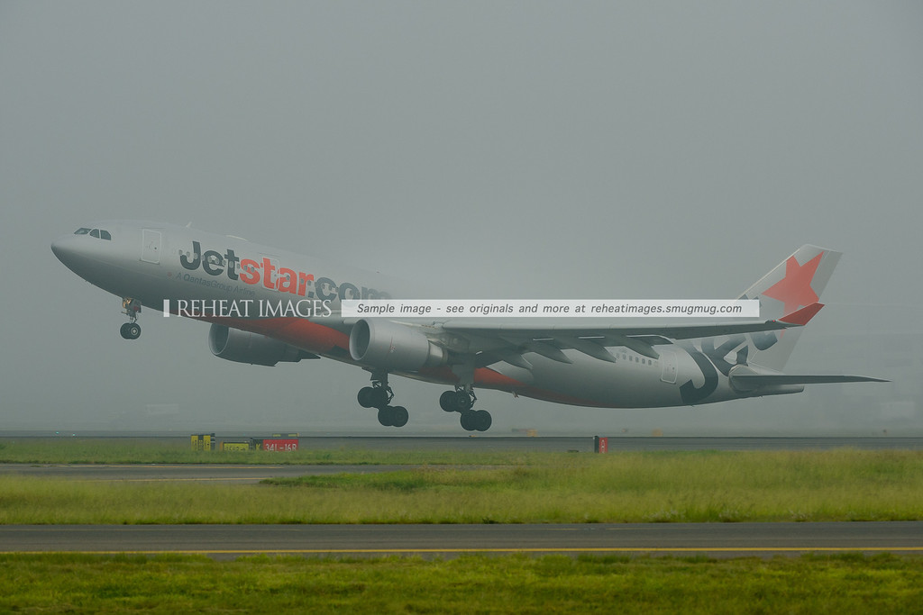 Jetstar Airbus A330-200 takes off from Sydney in heavy fog.