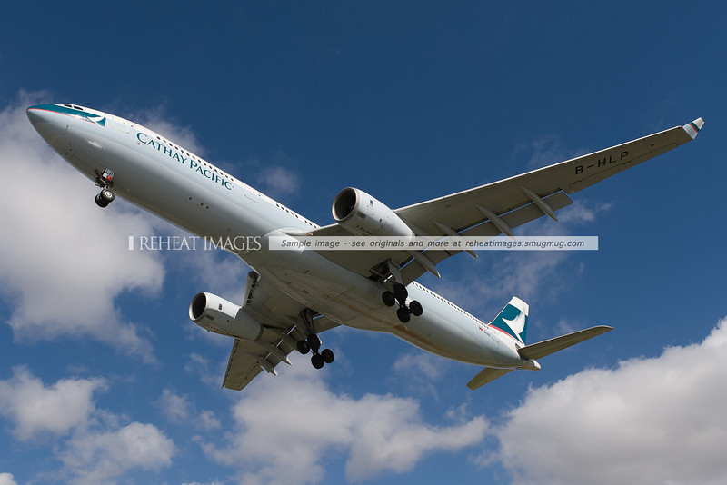 Cathay Pacific Airbus A330 lands at Sydney airport. It is seen here passing very low over Qantas Drive.