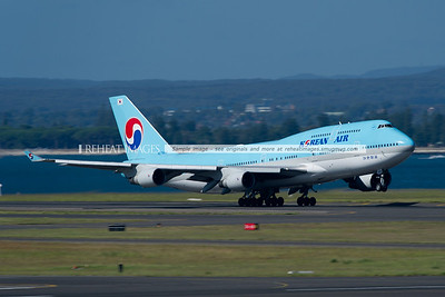 Korean Air Boeing 747-400 takes off from Sydney airport on a very hot morning.