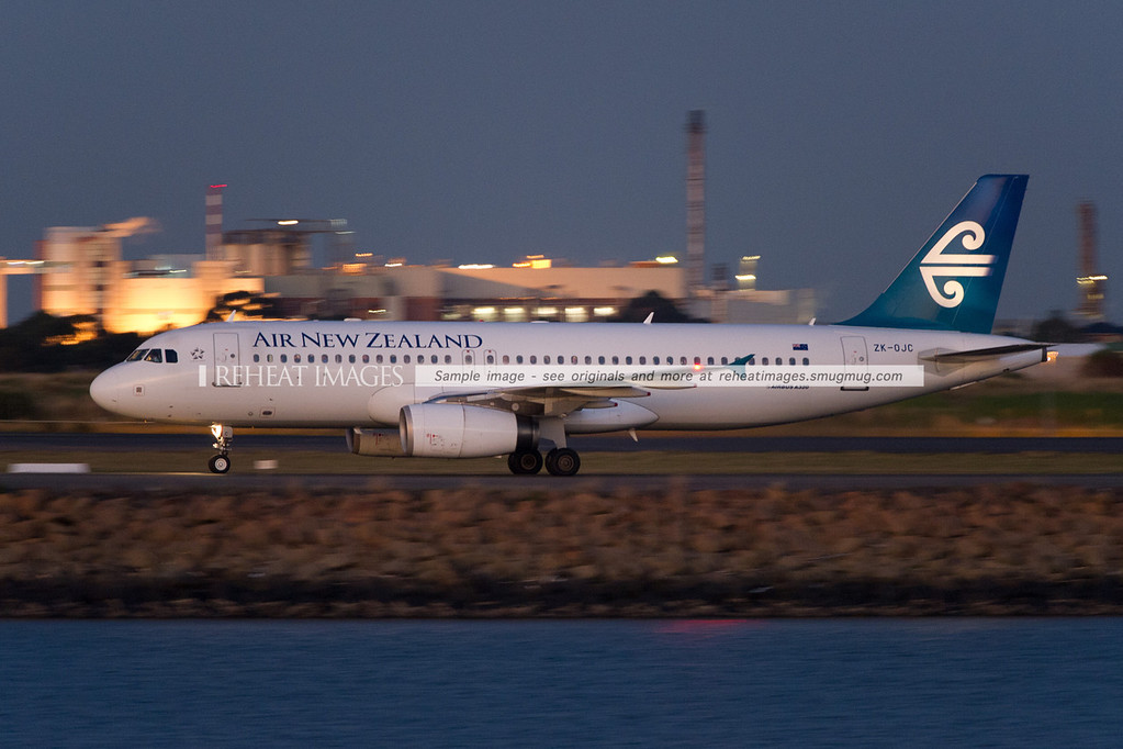 Air New Zealand Airbus A320 at Sydney airport, seen here at dusk.