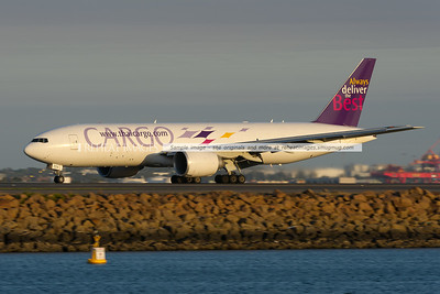 Thai Cargo Boeing 777-200F arrives in Sydney airport at sunset. The plane is operated by Southern Air.