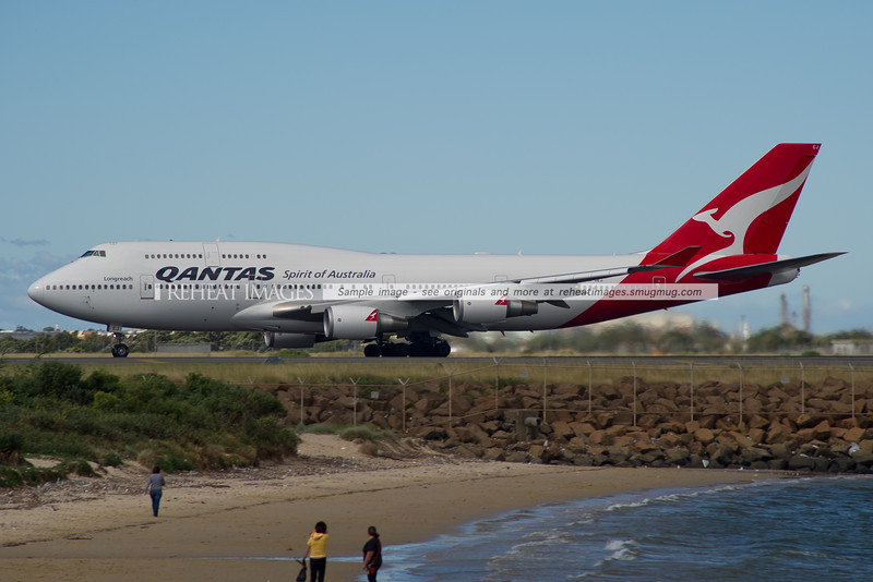 The former Wunala Dreaming VH-OEJ takes off from Sydney airport on a very windy day.