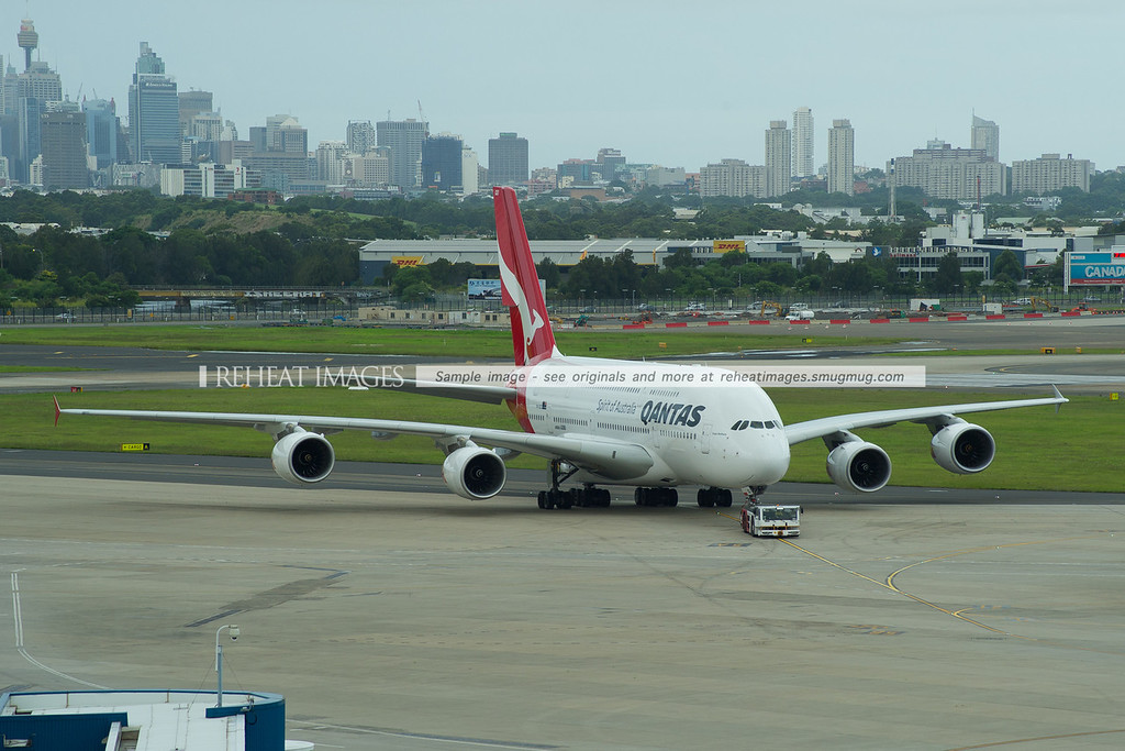 Qantas A380-842 VH-OQD being towed to the international terminal in preparation to operate QF31 to Singapore - quite a bit later than its usual departure time. By the time QF32 arrived from Singapore (sister A380 VH-OQK), QF31 had still not left.