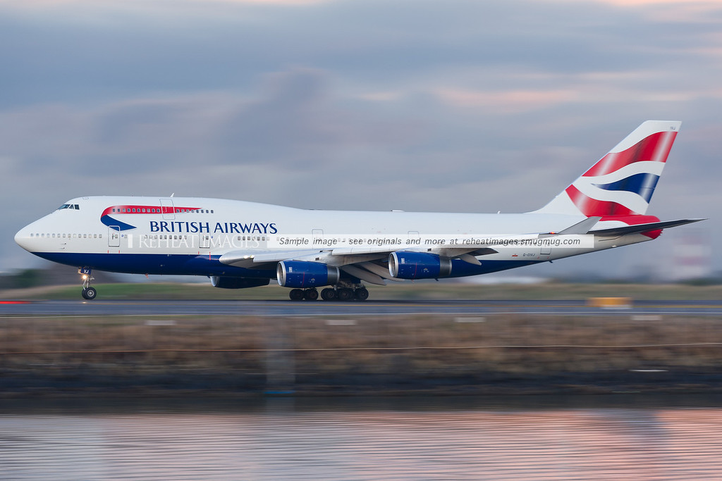 British Airways B747-436 is taking off from runway 34 left at Sydney airport. The background and foreground is blurred by the low shutter speed.