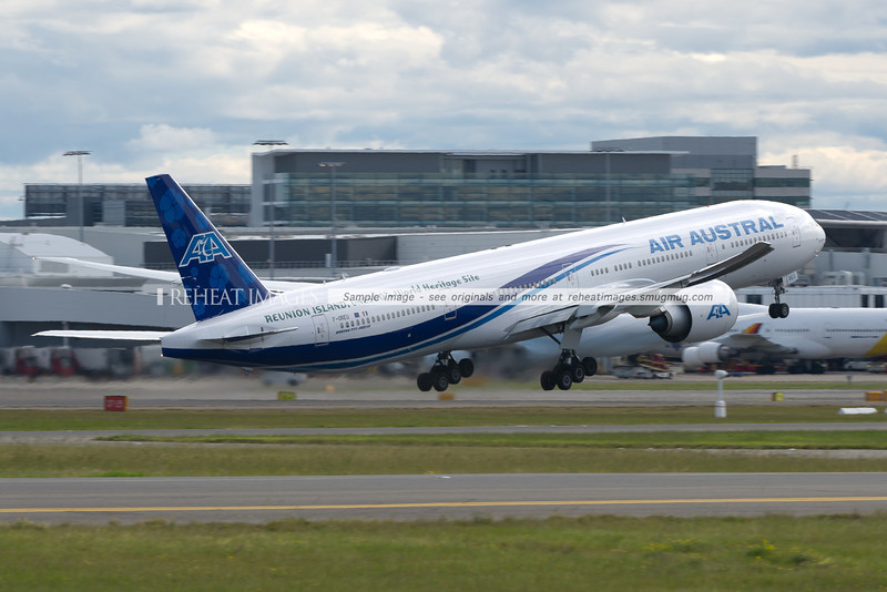 Air Austral Boeing 777-39M/ER leaves Sydney airport. The plane carries titles of Reunion Island, Unesco, A World Heritage Site / Patrimoine Mondiale de l'Unesco