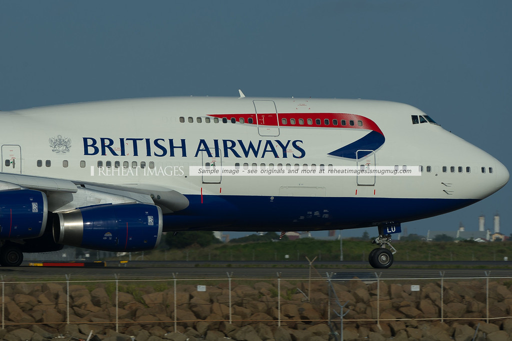 "This British Airways 747-436 has the coat of arms ""to fly to serve"" that links in with their new commercial ""the aviators"". The coat of arms comes from the days of the Landor colour scheme."