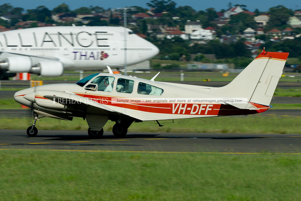 Beechcraft D55 Baron at Sydney airport - taxiing out to runway 34R.