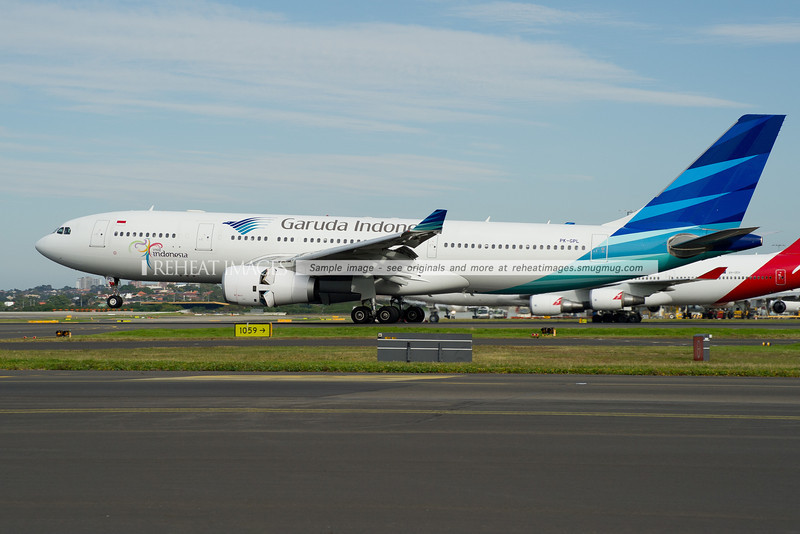 A Garuda Indonesia Airbus A330-200 lands at Sydney Airport on runway 16 right.