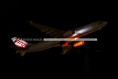Virgin Australia A330-200 VH-XFG takes off from Sydney airport runway 34 left at night.