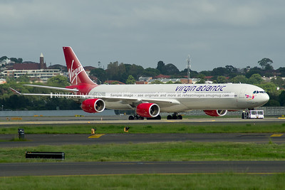 Virgin Atlantic Airbus A340-642 G-VRED is being pushed back to its parking location at Sydney airport.