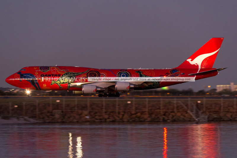 "Qantas' fantastic red B747-438/ER called ""Wunala Dreaming"" has landed at Sydney airport on runway 34 left under the cover of darkness. But not dark enough to stop a Nikon D3S and AF-S VR Zoom-Nikkor 200-400mm F/4.0G IF-ED from capturing the magnificent colour scheme."
