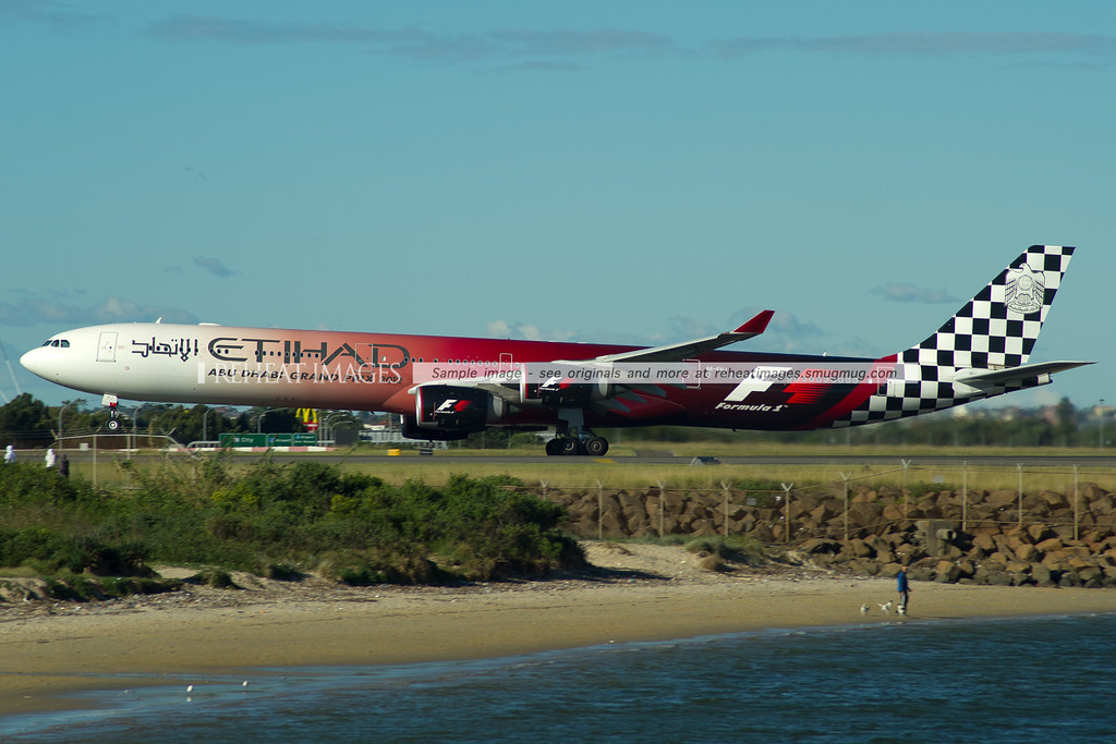 Etihad Airbus A340-642 A6-EHJ wearing the Abu Dhabi Grand Prix 2012 Formula 1 colour scheme departs Sydney on a very windy afternoon.