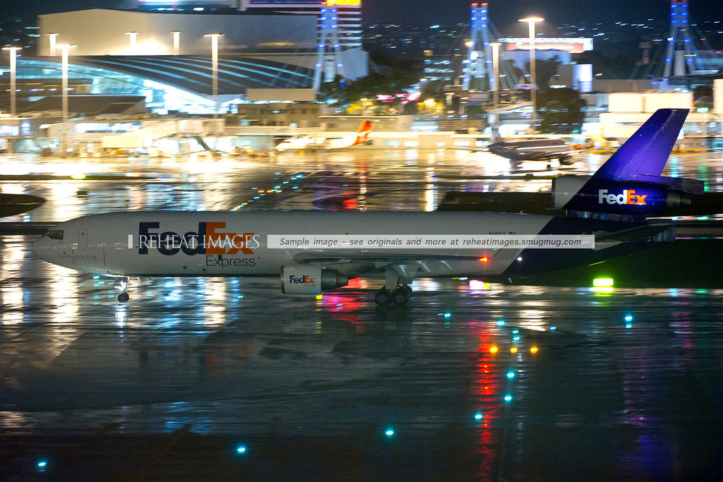 Fedex McDonnell Douglas MD-11F freight aircraft at night in Sydney airport in rainy conditions. This shot was taken with ISO10,000.