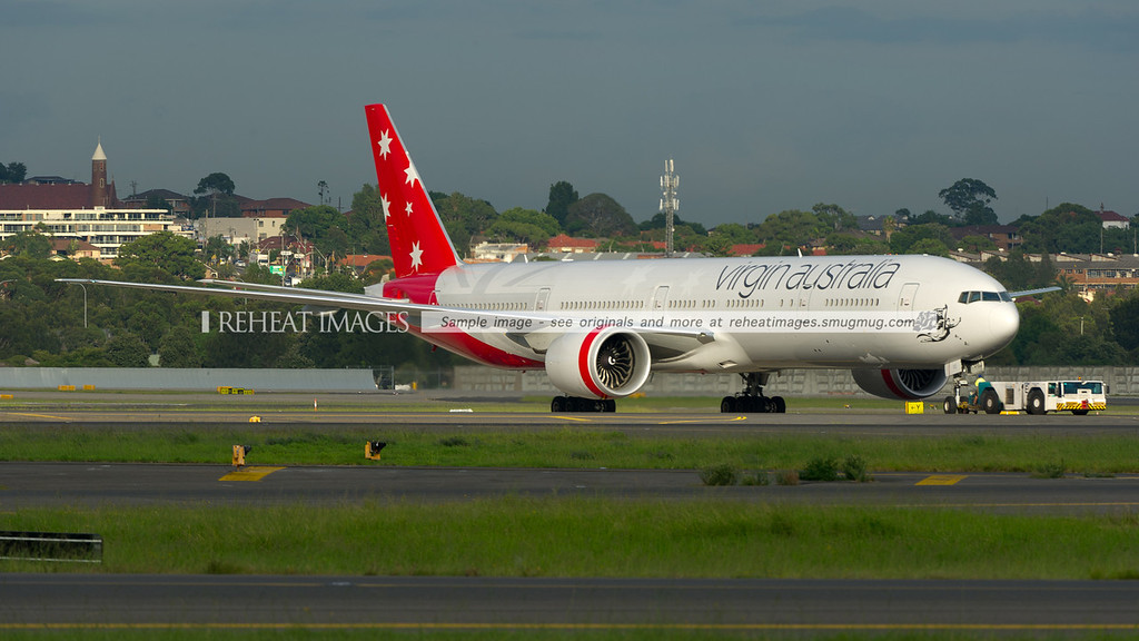 Virgin Australia Boeing 777-300/ER at Sydney airport being pushed to parking