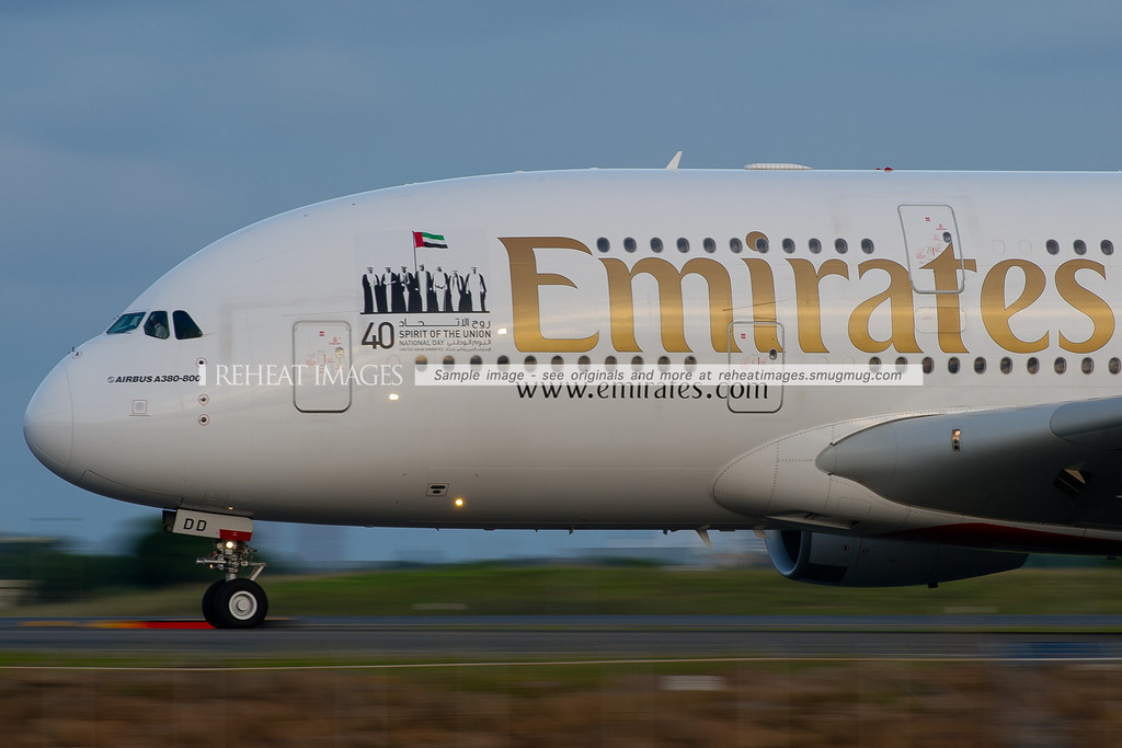 This Emirates Airbus A380-861 wears a special decal commemorating the federation of the 7 emirates forming the United Arab Emirates, Abu Dhabi, Ajman, Dubai, Fujairah, Ras al-Khaimah, Sharjah and Umm al-Quwain.. It looks wonderful in large size on the side of the Airbus A380.