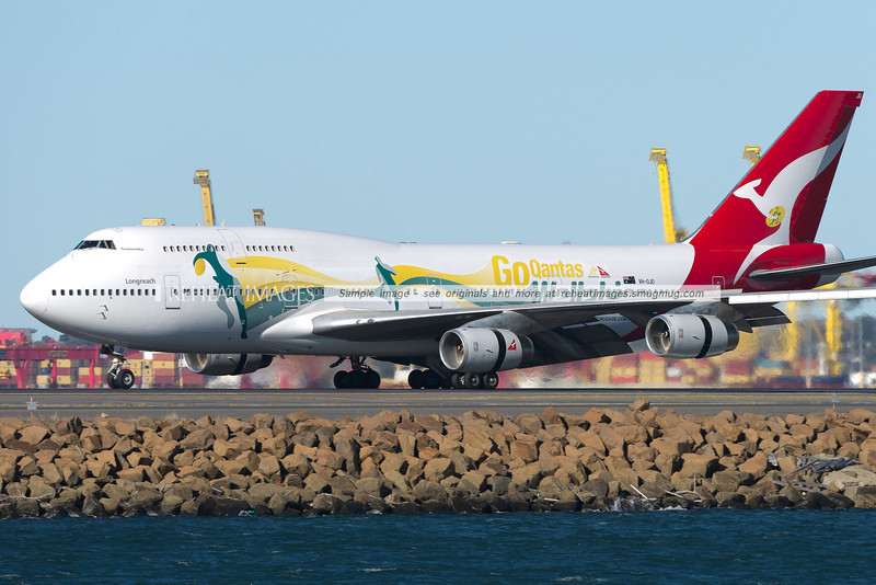 A Qantas B747-438, flight QF64 from Johannesburg is wearing a promotional colour scheme for the Qantas Wallabies, the Australian rugby team.