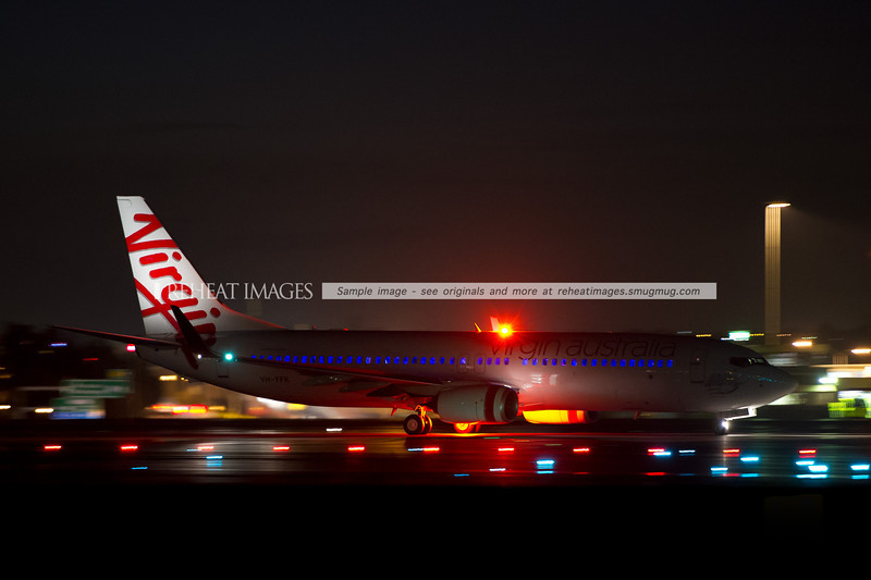 Virgin Australia B737-800 with the sky interior arrives at Sydney airport.