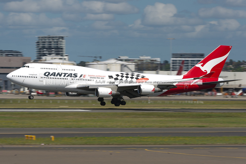 This Qantas 747-48E wears a promotional colour scheme for the F1 Qantas Australian Grand Prix 2011. It is just about to touch down on runway 16 right.