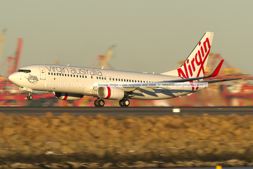 "Virgin Australia B737-800 takes off from Sydney airport. This plane is named ""Bondi Beach"". The low shutter speed gives a sensation of speed."