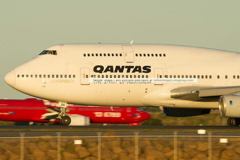 A close up view of a Qantas Boeing 747-438 departing Sydney airport on runway 34L.