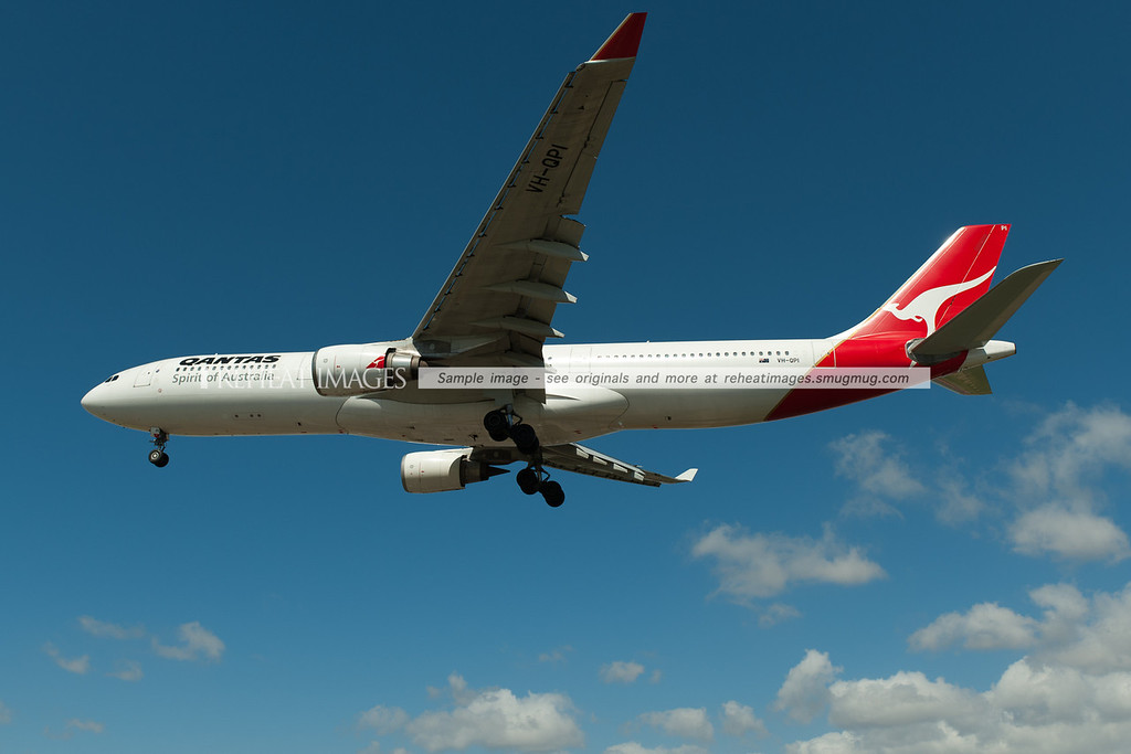 Qantas Airbus A330 lands at Sydney airport. It is seen here passing very low over Qantas Drive.