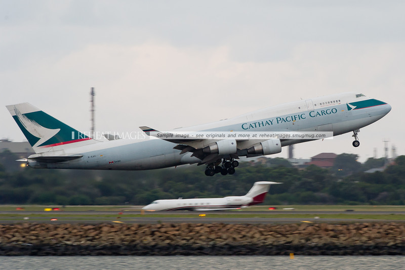B-KAE, a Boeing 747-412BCF takes off from Sydney airport as CX024 with Gulfstream N36GV in the background. The Cathay Cargo soon aborted its flight to Hong Kong and returned back to Sydney.