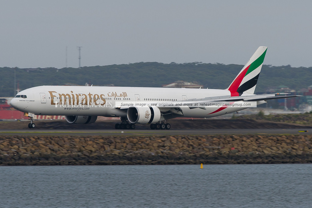 Emirates B777-300/ER A6-ECQ lands in Sydney.
