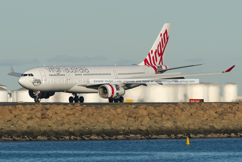 "Virgin Australia Airbus A330-200 lands at Sydney airport. This plane is named ""Cable Beach""."