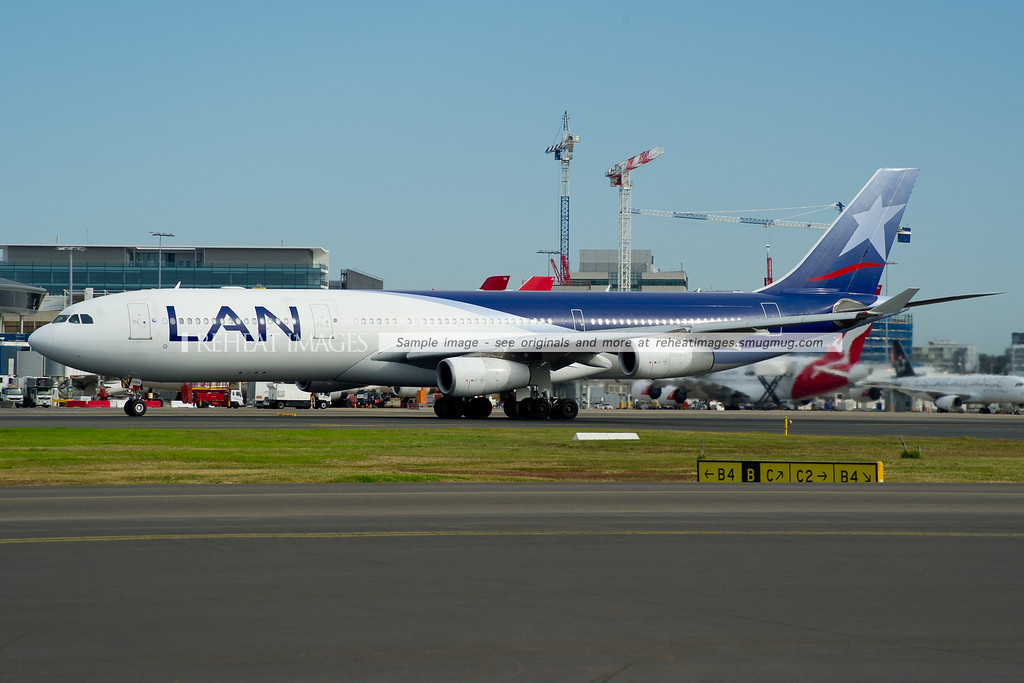LAN Airbus A340-300 departs Sydney Airport.