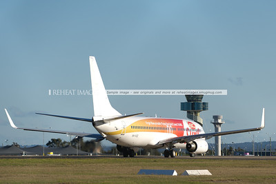 Virgin Blue B737-800 takes off from Sydney airport. It is wearing a promotional colour scheme for the Gold Coast Suns AFL team.
