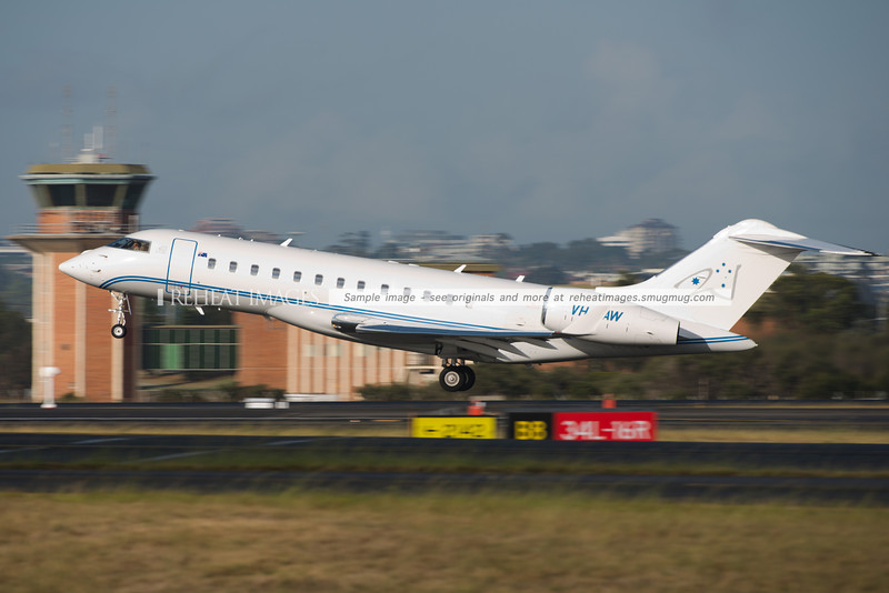 Bombardier Global Express VH-LAW leaves Sydney airport headed for Melbourne.