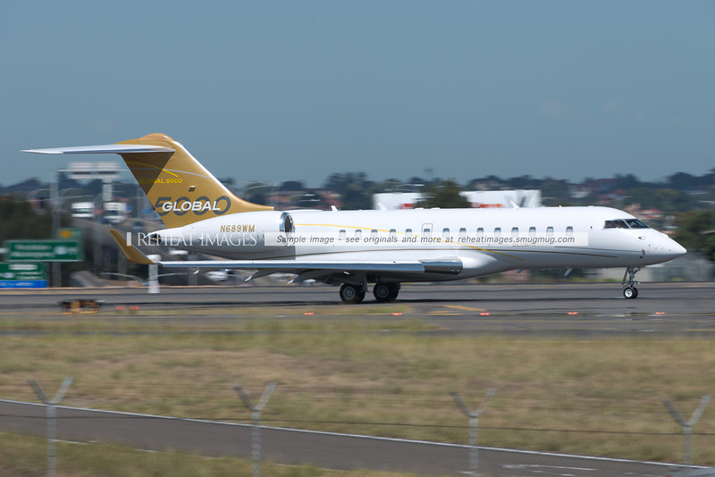 Bombardier Global 5000 N689WM arrives in Sydney, wearing the full Bombardier Global 5000 house colour scheme.