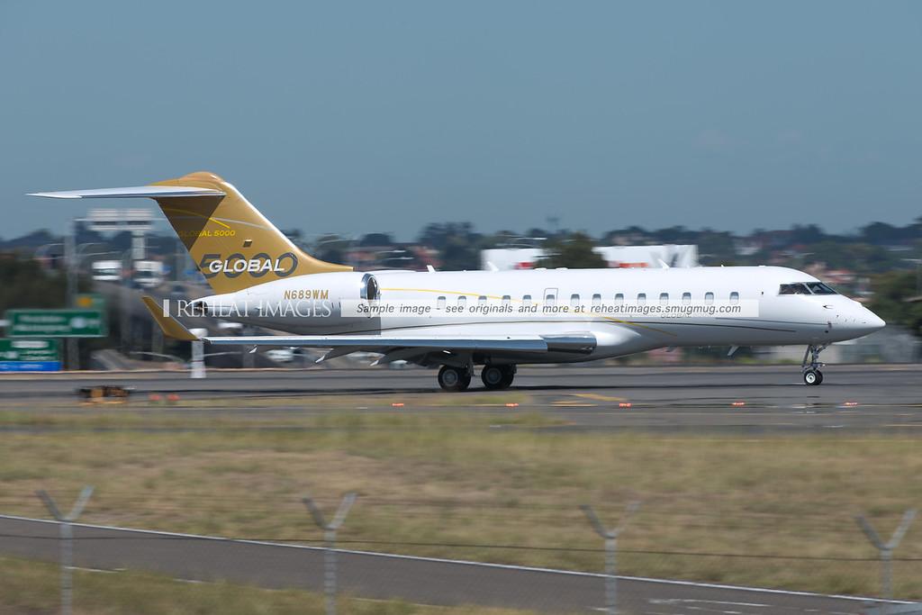Bombardier Global 5000 N689WM arrives in Sydney, wearing the full Bombardier Global 5000 house colour scheme.