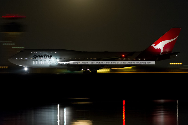 Qantas 21 Boeing 747-400 VH-OJL takes off from runway 34 left at Sydney airport.