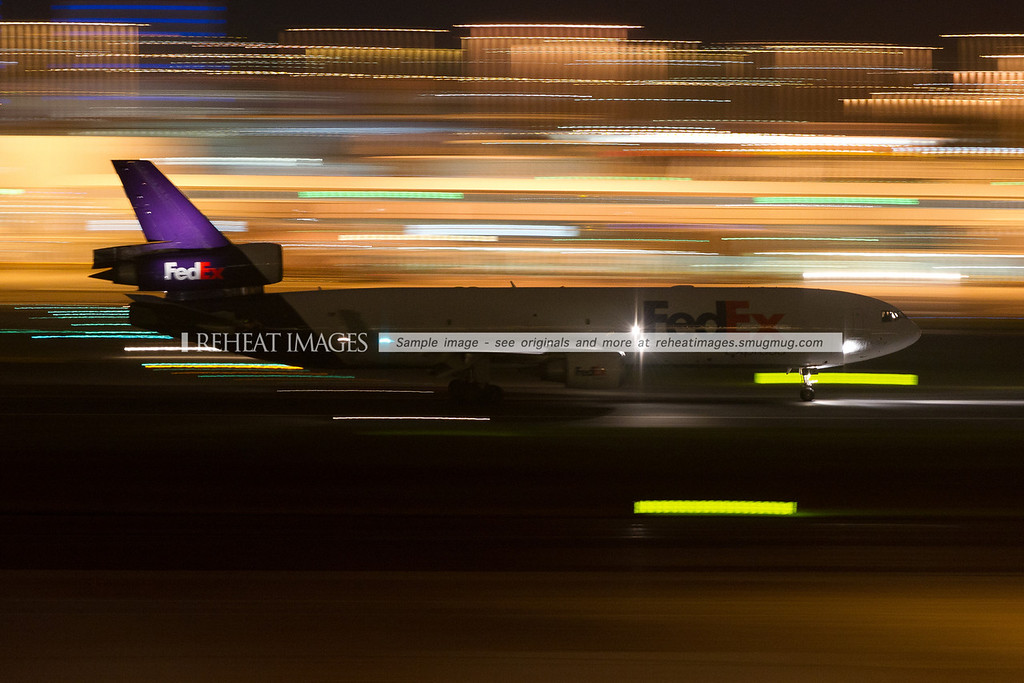 A FedEx MD-11F takes off from Sydney airport at night.