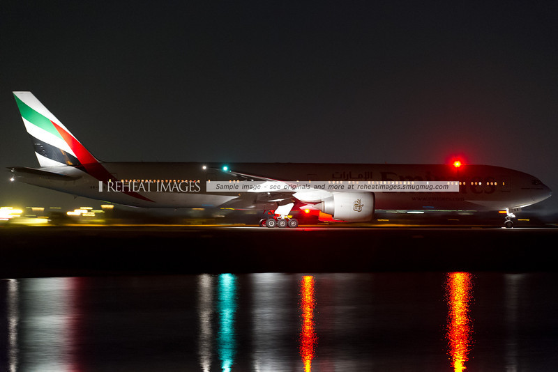 Emirates Boeing 777-300/ER A6-EGA heads out to the runway late on 1 January 2013. The plane then stopped and taxied across runway 34 left before heading back to the terminal.